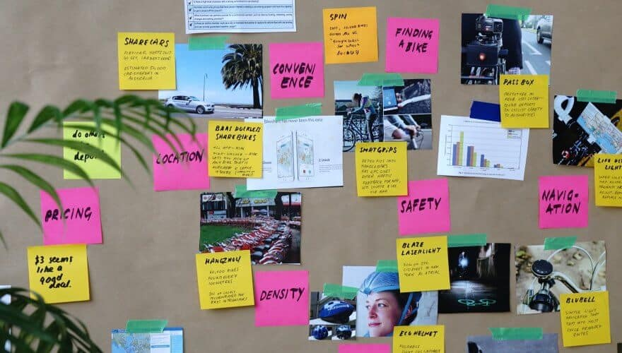 Photo of post-it notes that shows learning as output of students, not of trainers.
